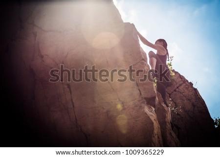 Young Climber Rock Climbing #1009365229