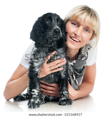 Young cocker spaniel and young smiling woman on white background