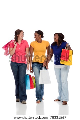 Young college age ladies/friends with shopping bags on white background