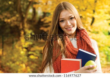 Young college girl portrait smiling at camera
