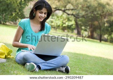 Young college student using laptop