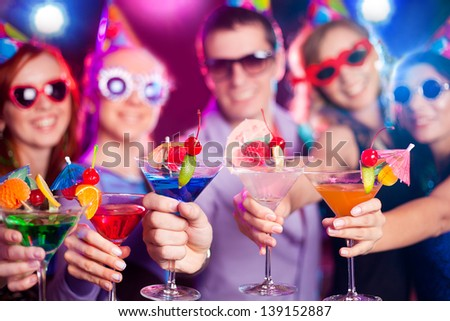 young company celebrates birthday with a cocktail in hand