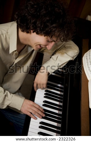 young composer enjoying his new song and smiling