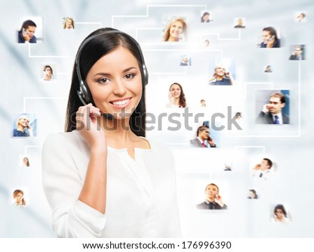 Young confident and beautiful customer support operator working in a call center