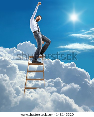 young confident businessman standing at the ladder high in the sky reaches the top / young man in shirt and tie pulls his hand up to the sky on top of the ladder on heaven