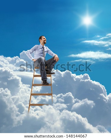 young confident businessman standing at the ladder high in the sky sits atop / young man in shirt and tie relaxing sitting on top of the ladder in heaven