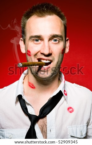 young confident man with cigar and lips imprints