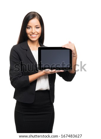 Young, confident, successful and beautiful business woman with the tablet computer isolated on white
