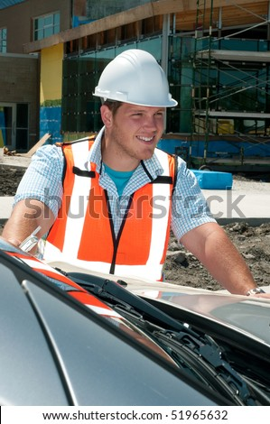 Young Construction Professional Supervising A New Commercial Building