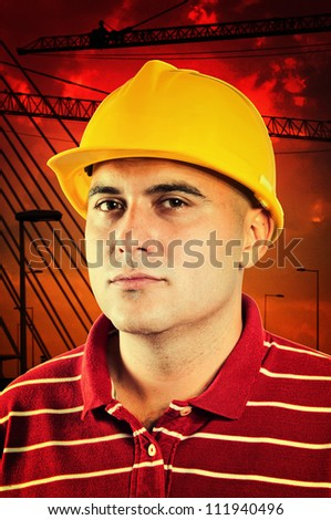Young construction worker in red shirt wearing yellow hard hat safety equipment.