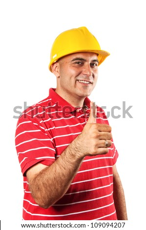 Young construction worker in red shirt wearing yellow hard hat safety equipment isolated on white background showing OK sign with his thumb, thumbs up.
