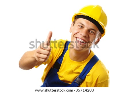 Young construction worker showing thumb up sign, isolated over white
