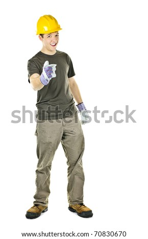 Young construction worker with hard hat pointing isolated on white background
