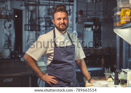 Young cook in the kitchen