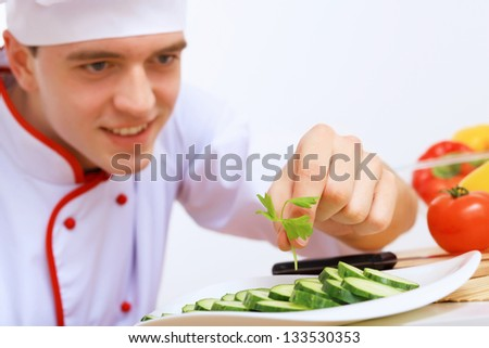 Young cook preparing food from fresh vegetables