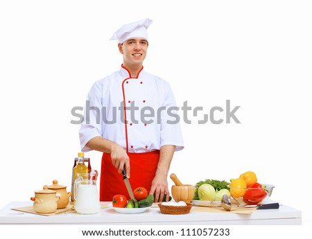 Young cook preparing food wearing a red apron