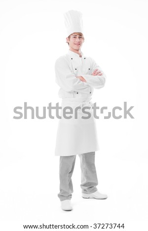 Young cook with arms crossed - stock photo