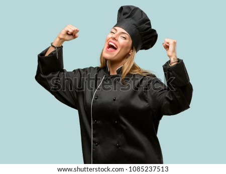 Young cook woman happy and excited celebrating victory expressing big success, power, energy and positive emotions. Celebrates new job joyful #1085237513