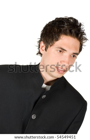 Young cool beginner priest in low angle view smiling  isolated on white background - stock photo