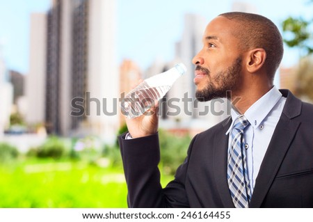 young cool black man drinking water