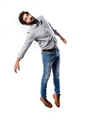 young cool man full body jumping