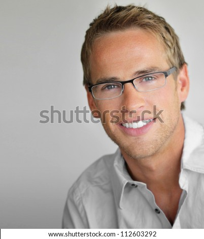 Young cool trendy man with glasses smiling