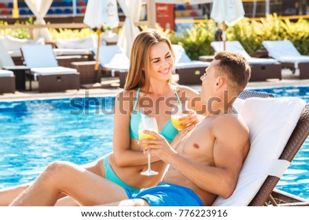 Young couple active leisure swimming pool concept #776223916