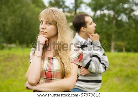 young couple after quarrel outside. Focus on girl only