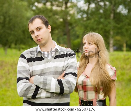 young couple after quarrel outside. Focus on man only