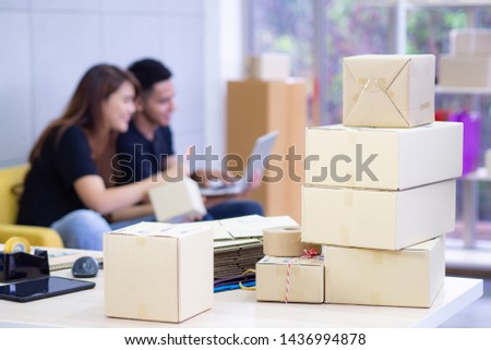 Young couple are a new ecommerce entrepreneurs, working as a teamwork and using various technologies internet for the business efficiency whether it is a website and various social media