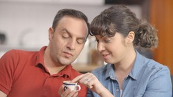 Young couple are fortune telling after drinking coffee at home. A man looking for coffee fortune after drinking coffee.