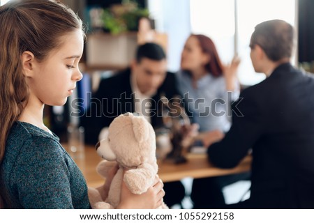 Young couple arranges guardianship of little girl. Registration of guardianship. Family in office of family lawyer. Two parents fighting over child in divorce concept.
