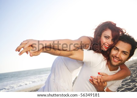 Young couple at the beach posing