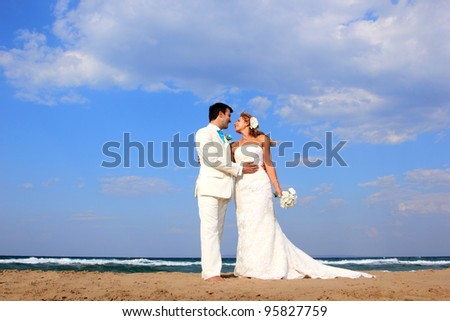 Young couple at their beach wedding