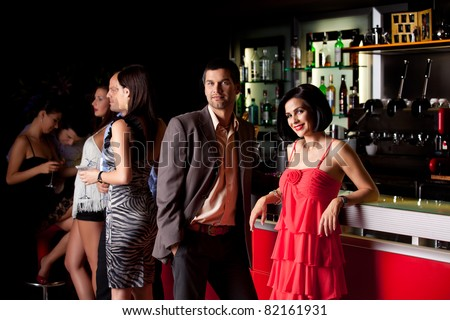 young couple bar counter having fun smiling