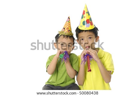Young couple Boy Blowing a Party Favor and Wearing a Party Hat