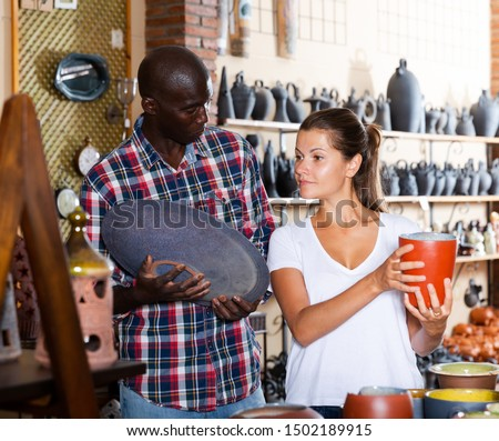 Young couple buys earthenware in a store