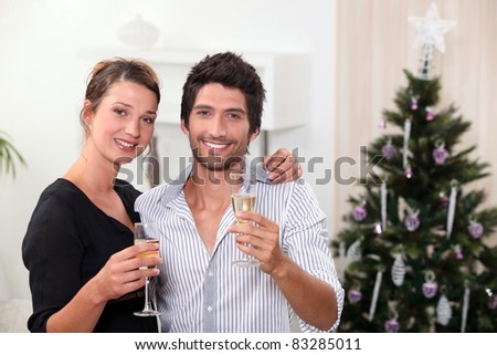 young couple celebrating New Year\'s Eve