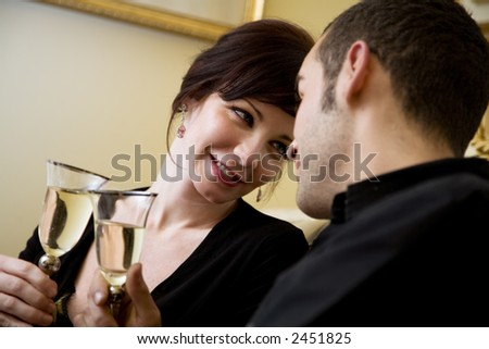 young couple celebrating some occasion and having fun - stock photo