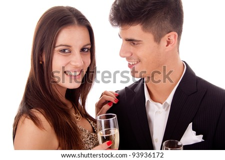 Young couple celebrating with champagne - Valentine's