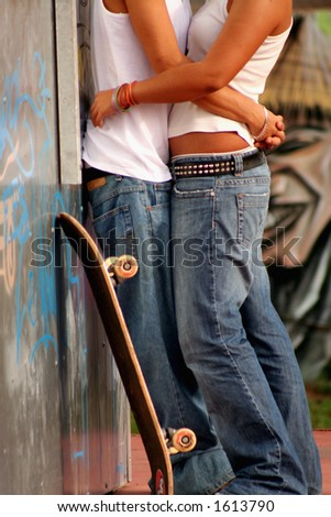 Young couple cuddling in a skate park