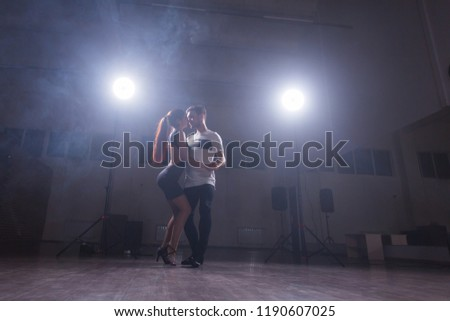 Young couple dancing latin dance Bachata, merengue, salsa. Two elegance pose in dance class #1190607025