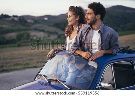 young couple doing a road trip...