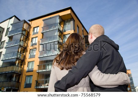 Young couple dreaming of a new home