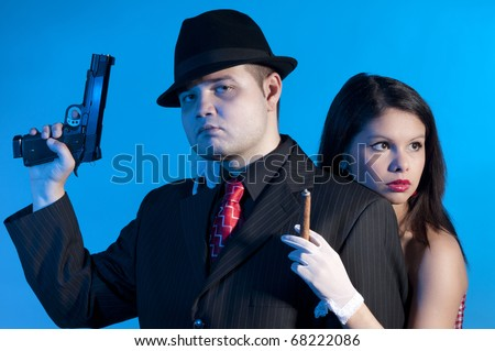 young couple dressed elegant playing as criminals