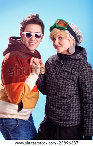 young couple dressed in winter clothes, holding hands