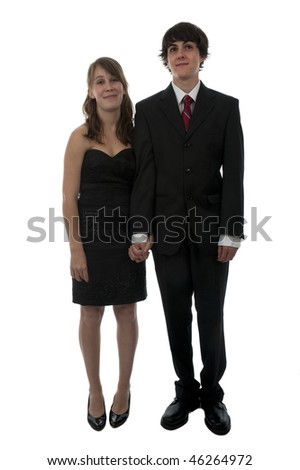 Young couple dressed up in formal wear for prom night date.