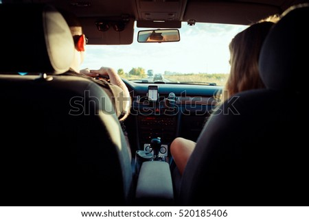 Young couple driving a car. Long journey