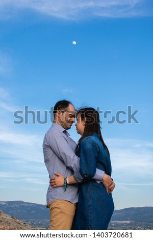 Young couple embraced with the moon in the background. Lifestyle, just married. #1403720681