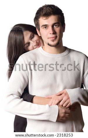 Young couple embracing, looking at camera